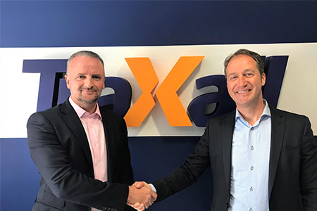 Ross Jackson shakes hands with Leomont Wouda, international Business Director of TraXall